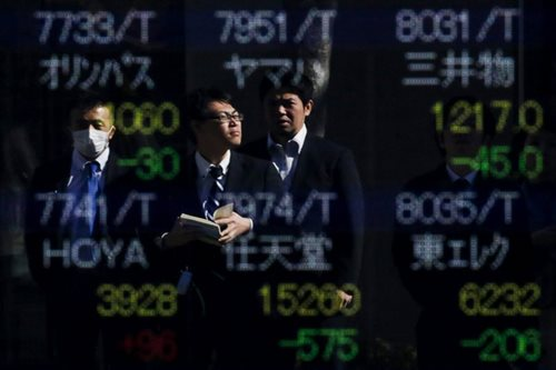Asian shares fall as China set to reopen after Beijing eases policy