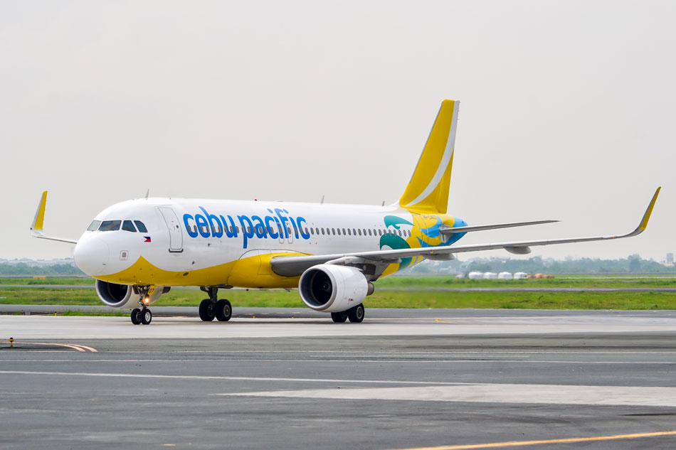 A Cebu Pacific Plane Is Shown On The Runway