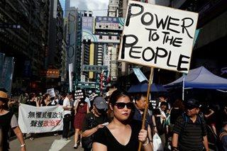 Hong Kong leader says Asian financial hub faces 'grave' challenges