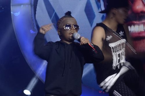 Xia Vigor raps as apl.de.ap in 'Your Face'