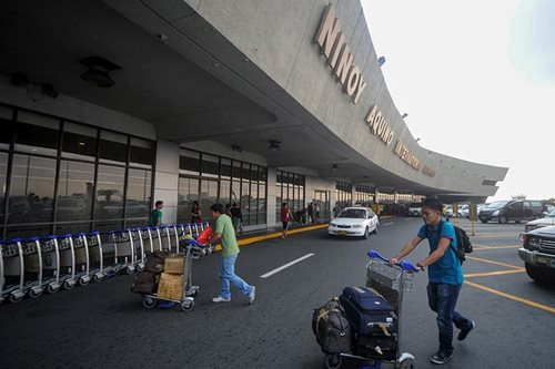 Airport police nab taxi driver for robbing OFW's wife