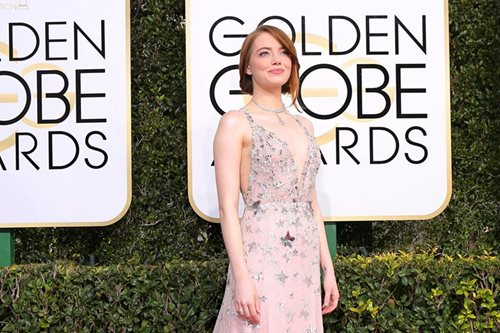 Lots of pink on parade on Globes red carpet