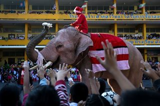 In Thailand, Santa Claus comes to town riding an elephant