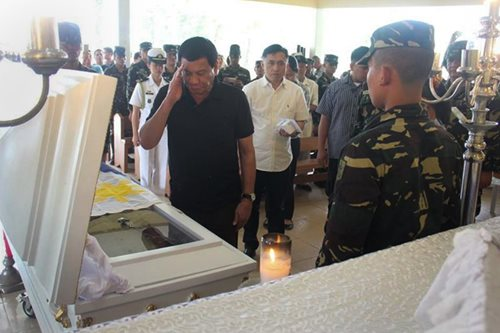LOOK: Duterte visits wake of slain soldier in Butuan City