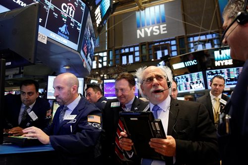Dow crosses 24,000 mark as banks climb, techs rebound