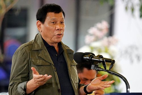 Duterte says anew he will pardon cops in Espinosa slay