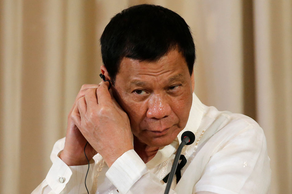 Philippines leader declares martial law on southern island as fighting rages