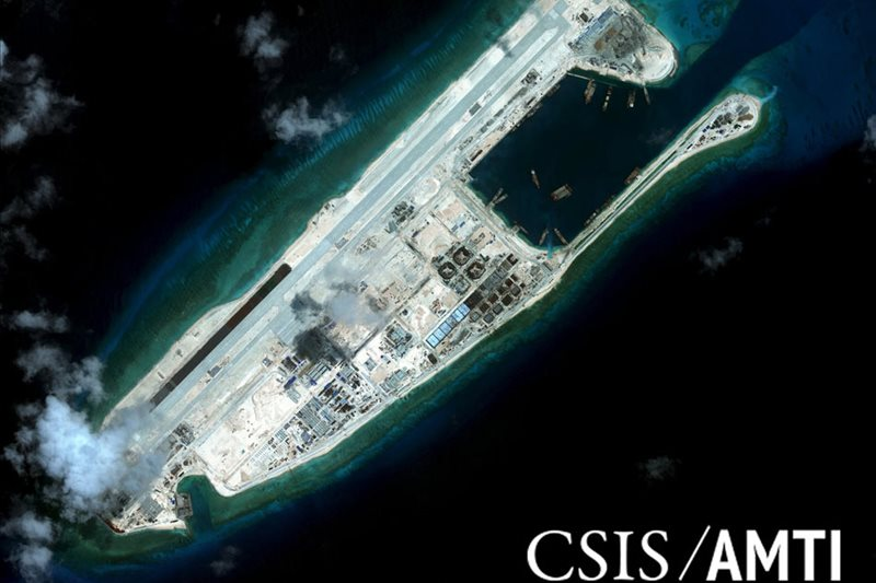 China unveils monument to South China Sea island building