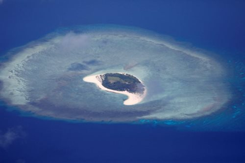 China urges halt to oil drilling in disputed South China Sea