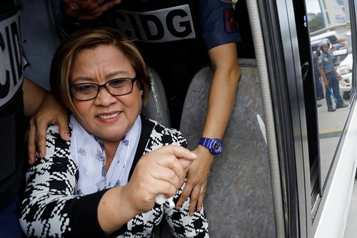 De Lima wants convicts against her as accused in drug case