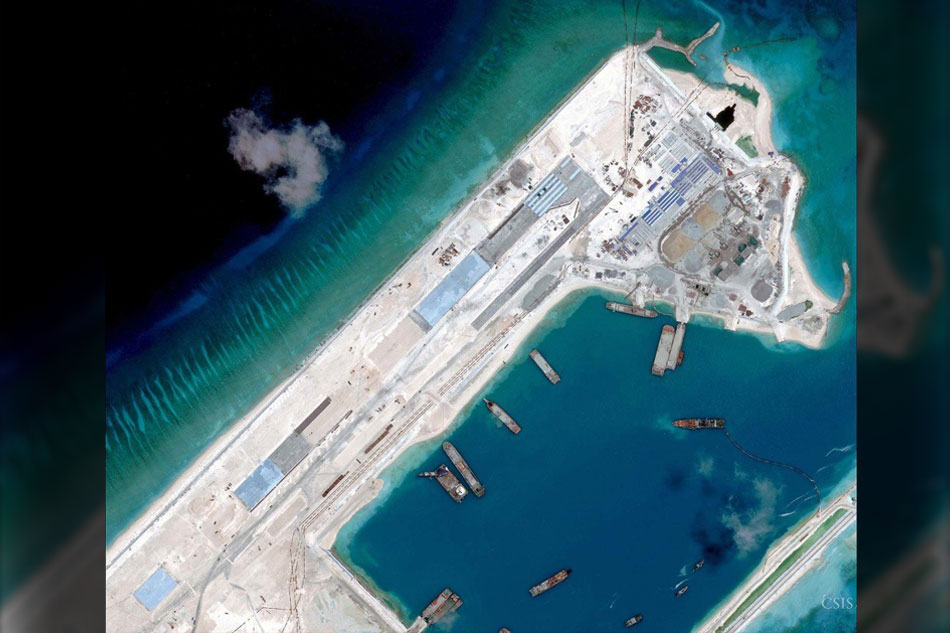 China installs rocket launchers on disputed reef in South China sea