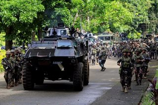 AFP tells Moro rebels to stay put, Reds to back down amid martial law