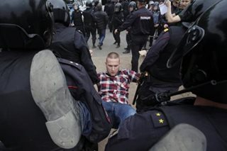 Anti-Kremlin protesters fill Russian streets, Putin critic Navalny jailed