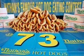 Man downs 72 hot dogs in 10 minutes to win US holiday eat-fest