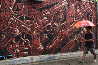 Red mural depicts war on drugs