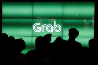 Regulators order Grab to cut surge fares