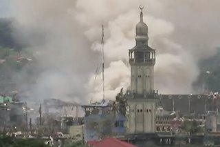 Gunmen perched on mosque open fire as Marawi burns