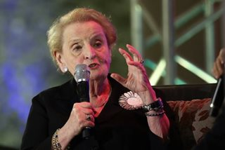 What 'statement pin' would Albright wear for Duterte?