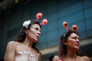 Topless activists parade through New York