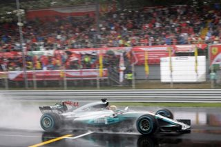 Rainmaster Hamilton takes record pole at Monza