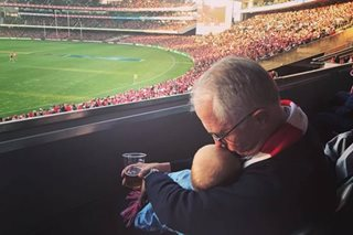 Australian PM defends baby and beer photo