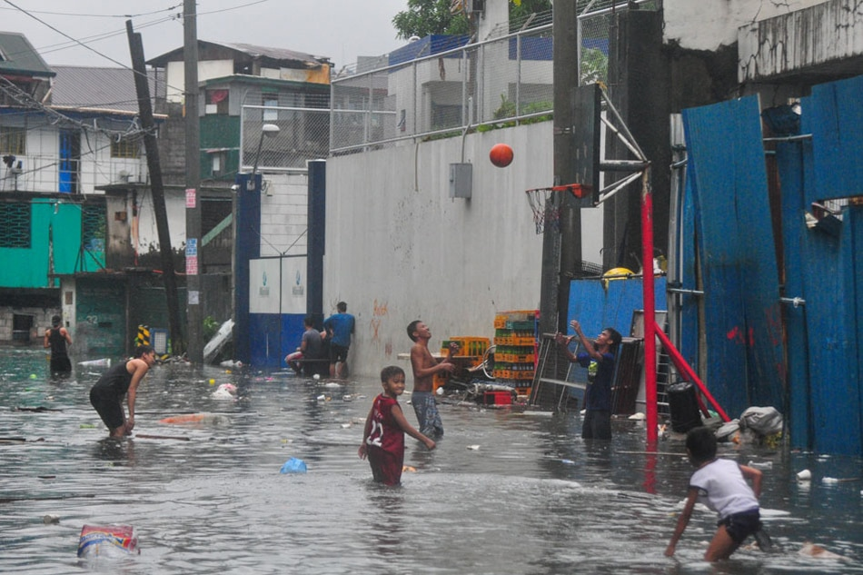 Just do it: Basketball even on flooded street
