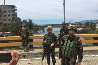 Military officials finally cross Marawi bridges retaken from Maute