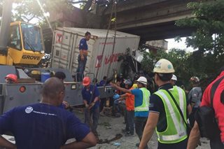 Truck falls from bridge in Manila