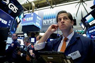 US stocks hit new records, but euro slides on Spanish clash