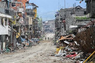 Unexploded bombs, bones greet Marawi residents on visit to 'ground zero'