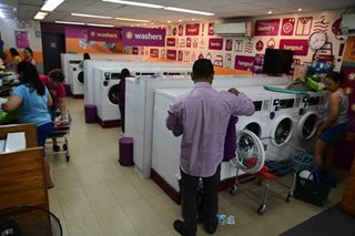 'Tingi' economy sees rise of self-service laundromats