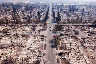 Fire razes neighborhoods in California