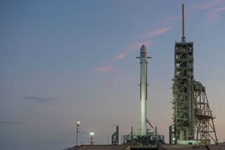 SpaceX launches, lands recycled rocket