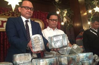 Missing P1,000 allows 2 ex-Immigration officials to evade plunder raps