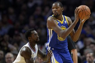 Warriors overpower Clippers, T-Wolves outlast Heat in OT