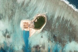Satellite images show China boosting military bases in S. China Sea