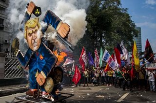 13-foot Trump effigy stars in anti-US rally