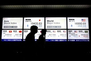 Asian shares slip as iron ore softens, euro near 3-year top