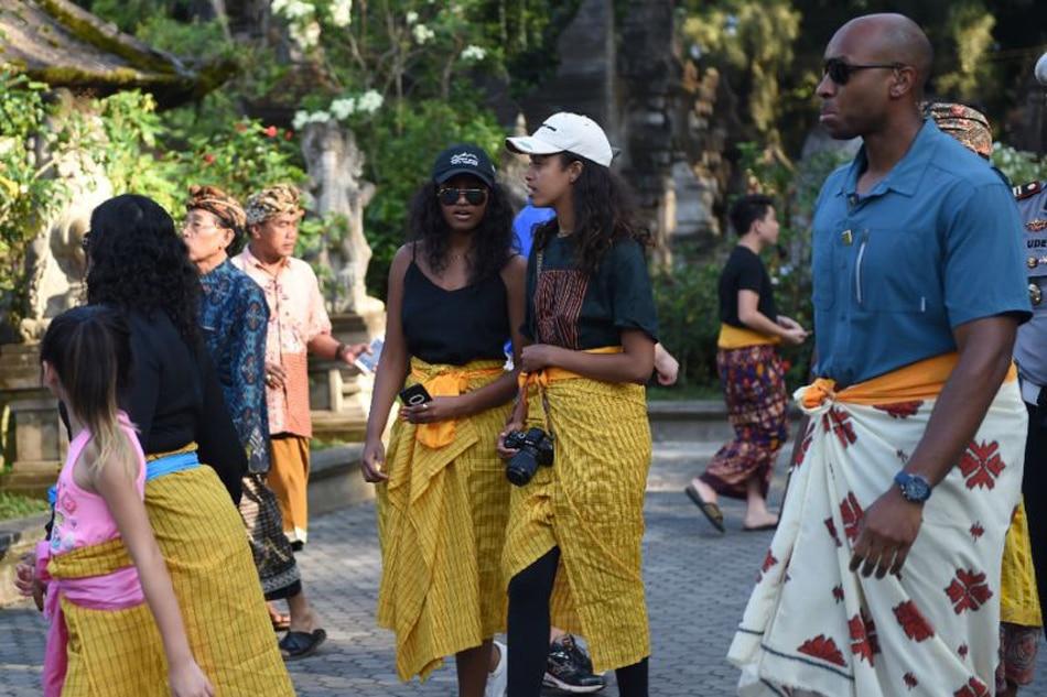 Malia Obama, her sister Sasha, visit a temple on the Indonesian island of Bali in June 2017. Sonny Tumbelaka AFP