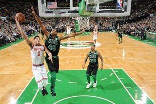 Booker shines but Celtics roll on