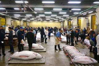 Japan's historic Tsukiji market holds final New Year auction
