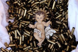 Monks put baby Jesus on bed of bullets to press for peace