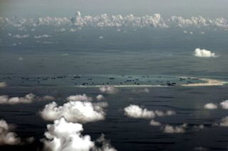 In first under Trump, US warship challenges Beijing's claims in S. China Sea