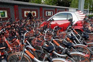 China starts regulating bike-sharing as complaints soar