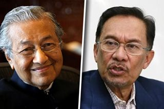 Malaysia's Mahathir says would back old foe Anwar as prime minister