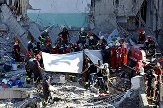 8 bodies found under collapsed building in Italy