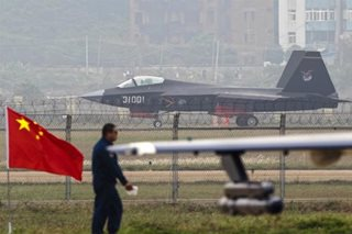 China says nothing will stop its long-range air force drills