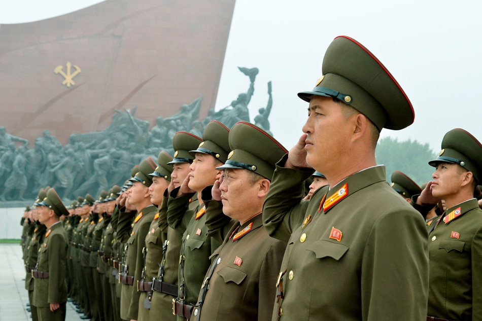 North Korean soldiers salute at Mansudae hill in Pyongyang North Korea on the 69th founding anniversary of the country. Kyodo via Reuters