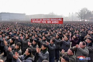 North Koreans celebrate missile test