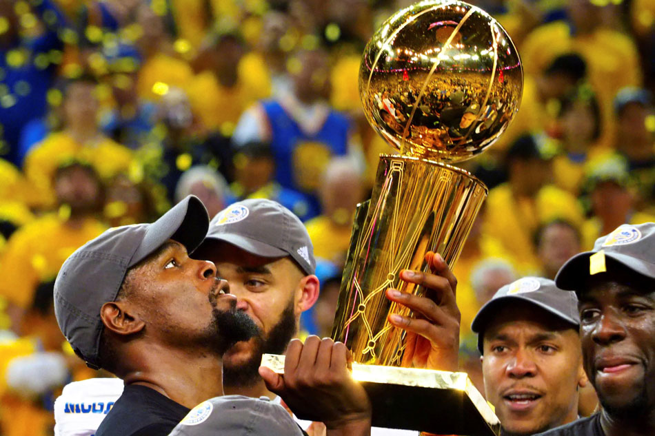 21b2136c67b Golden State Warriors forward Kevin Durant (35) celebrates with the Larry  O Brien Trophy after beating the Cleveland Cavaliers in Game 5 of the 2017  NBA ...